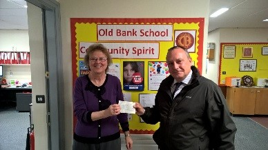 Steve handing the Cheque over to Miss Walker
