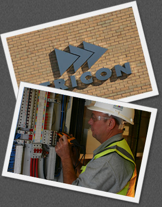 The Tricon logo on the side of our building overlapped by a builder working
